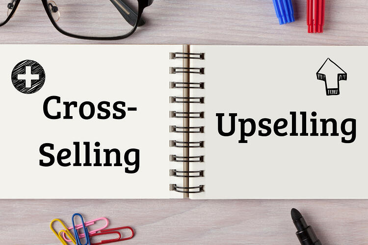 Cross- Selling vs Upselling   notebook on desk with office supplies