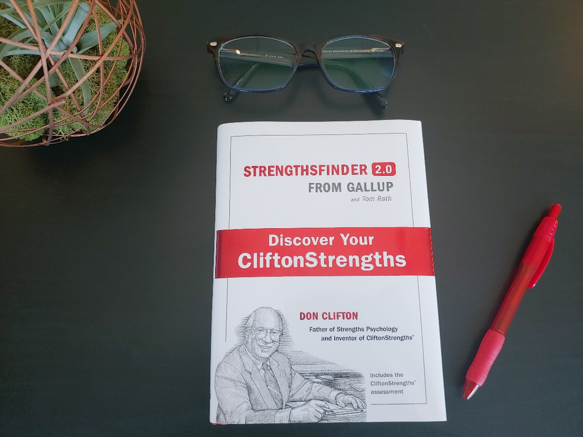 Sales Book | Strengthsfinder book on desk