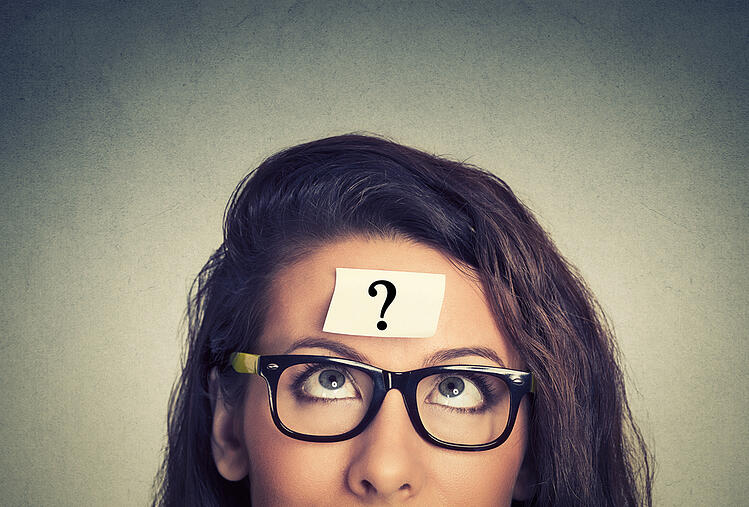 Content marketing - questions - woman with question mark post-it