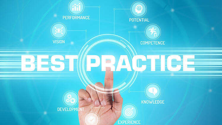 Upselling Best Practices   Cross-selling vs. Upselling   Hand pressing best practice on the screen